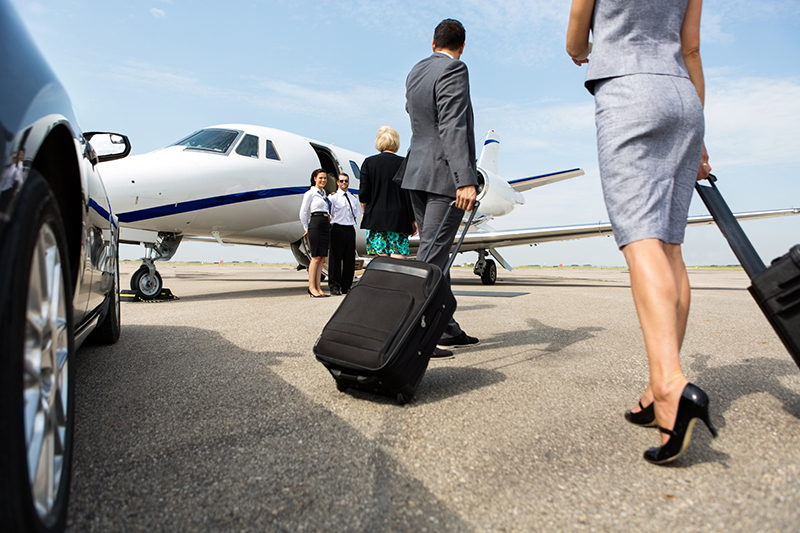 Businesspeople boarding private jet