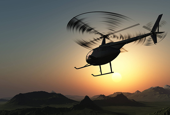 Helicopter flying near mountains