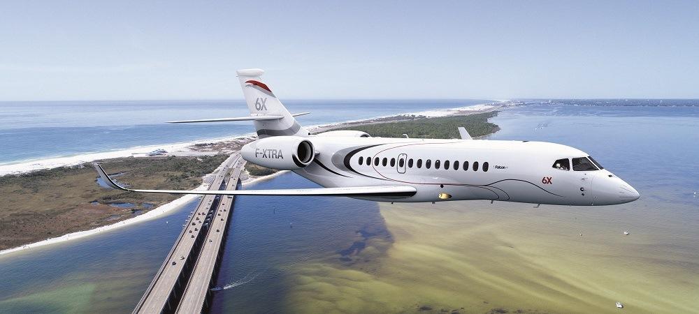Falcon 6X taking flight above the ocean
